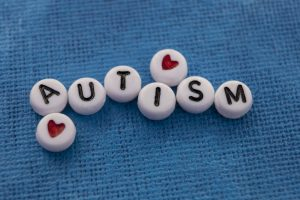 Beads with letters that spell out autism