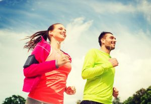 Man and woman running outside