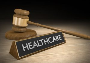 Healthcare Sign next to gavel