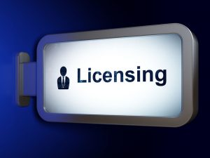 Sign with icnon of person and the word Licensing