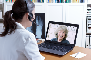 Doctor consulting patient via computer